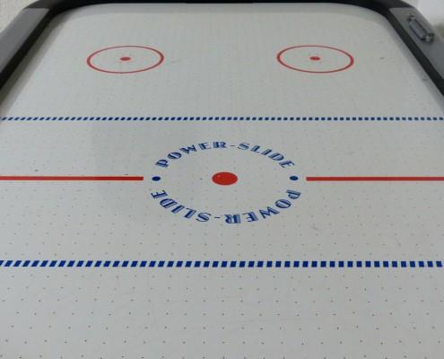 close-up photo of an air hockey table