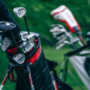 two golf bag full of golf club of different types and sizes