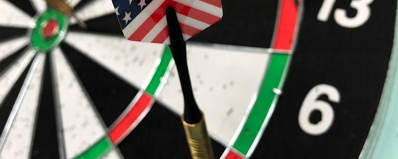 a dart hitting the dartboard