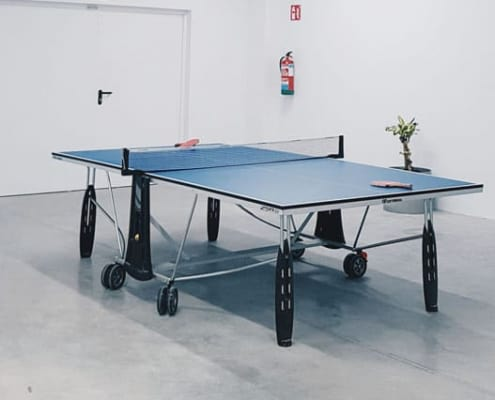 ping pong table inside a clean game room