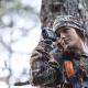 woman using range finder