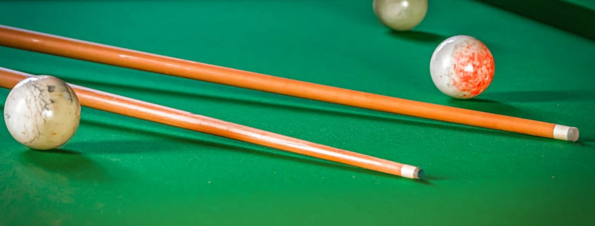 pool with pool cues and ball