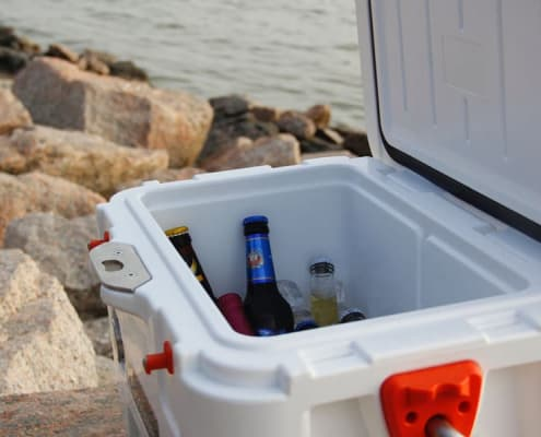 Cooler full of drinks in the shore