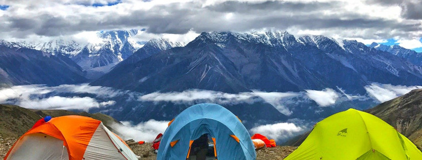 three tents pitched by the mountain view