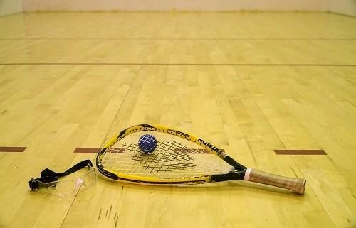 Ball beside yellow raquet
